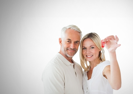 Digital composite of Couple holding key in front of Vignette