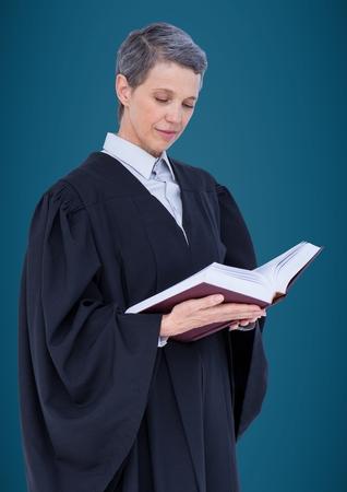 Digital composite of Female judge reading against blue background