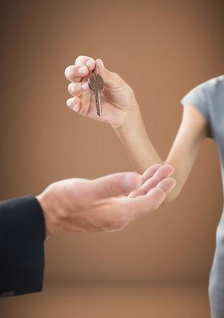Digital composite of Hands Holding key in front of vignette