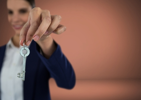 Digital composite of Woman holding key in front of Vignette Stock Photo
