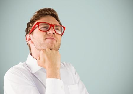 Digital composite of Nerd man thinking against light grey background