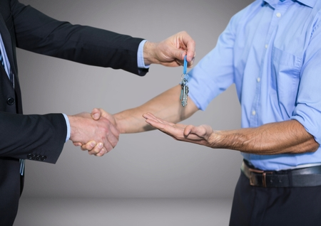 Digital composite of Holding key in front of vignette with handshake