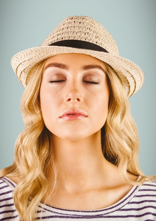 Digital composite of Close up of millennial woman with eyes closed against grey background
