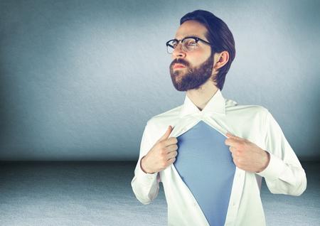 Digital composite of Millennial man opening shirt in blue room