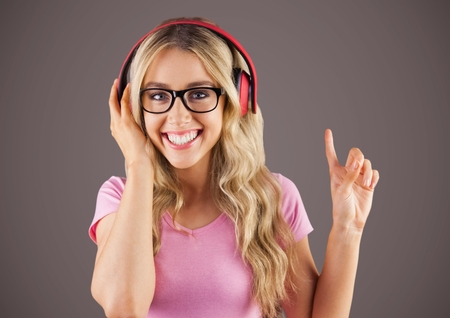 Digital composite of Millennial woman with headphones against brown background