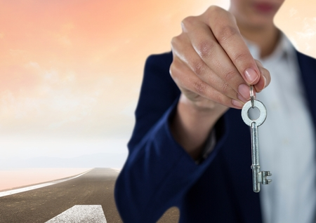 Digital composite of Woman  Holding key in front of road