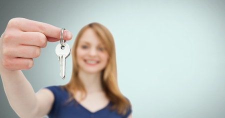 Digital composite of Woman Holding key in front of vignette