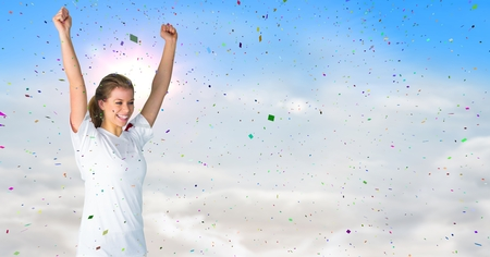 Digital composite of Woman cheering against sunny sky and confetti