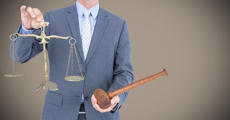 scale of justice: Digital composite of Male judge mid section with gavel and scales against light brown background