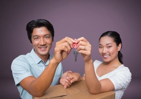 moving box: Digital composite of Couple Holding key in front of vignette