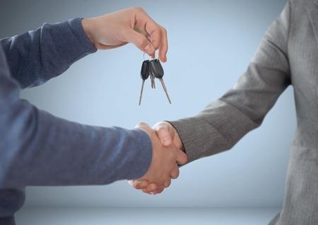 Digital composite of Hands Holding key in front of vignette with handshake
