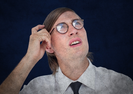 Digital composite of Close up of nerd man with grunge overlay scratching head against blue background