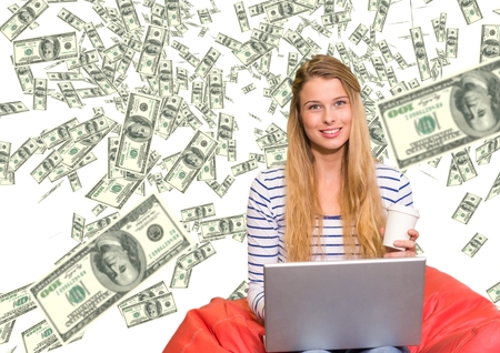 Digital composite of texting money. Young woman with laptop, money everywhere