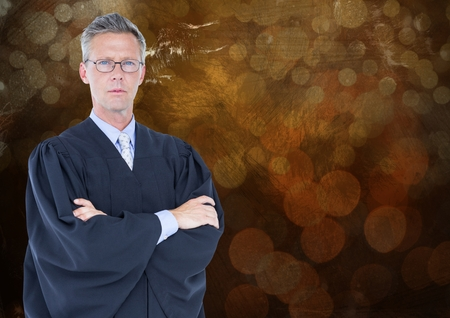 Digital composite of Male judge arms folded against brown bokeh Stock Photo