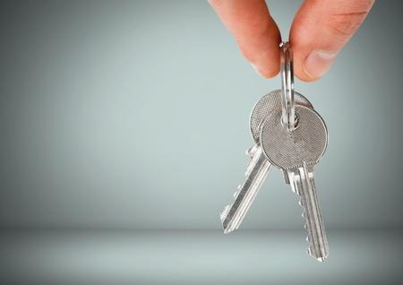 Digital composite of Hand Holding key in front of vignette