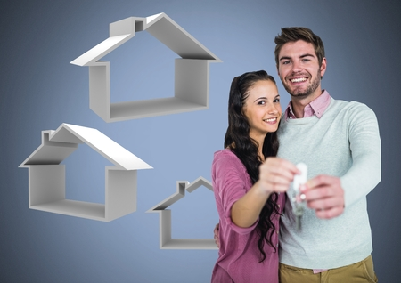 Digital composite of Couple Holding key with house icons in front of vignette Stock Photo