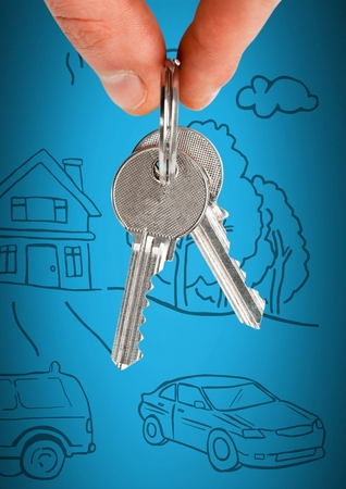 Digital composite of Hand Holding key with home drawing in front of vignette Stock Photo