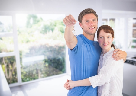 sink: Digital composite of Couple Holding key in kitchen