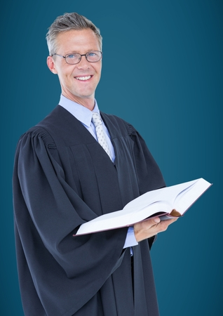 Digital composite of Male judge with open book against blue background Stock Photo