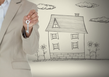 Digital composite of Hand Holding key with house drawing in front of vignette