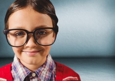 Digital composite of Close up of nerd boy in blue room
