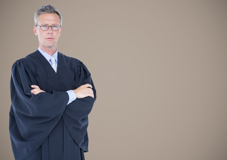 Digital composite of Male judge arms folded against brown background