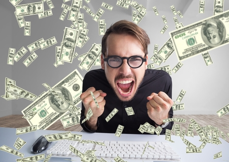 Digital composite of texting money. very happy man shouting in front of the computer, money everywhere