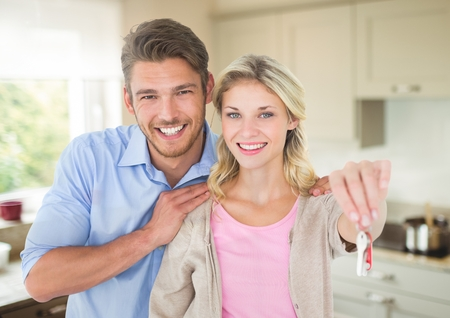 Digital composite of Couple Holding key in kitchen