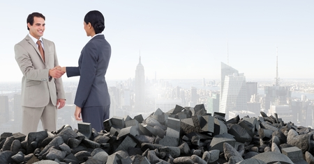 innumerable: Digital composite of Broken concrete pile and business people in cityscape