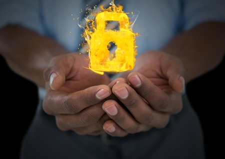 Digital composite of hands with lock fire icons over. Black background