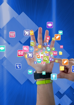 Digital composite of hand with application icons coming up from it. Technological background Reklamní fotografie