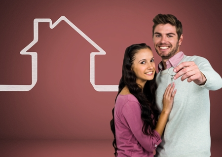 Digital composite of Couple Holding key with house icon in front of vignette Stock Photo