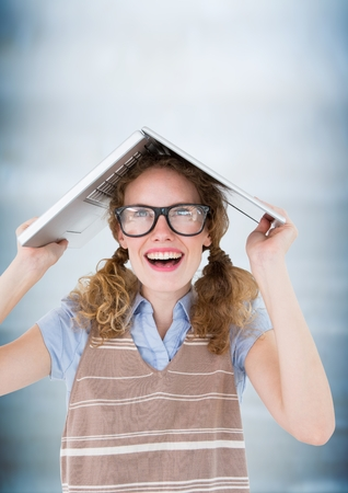 Digital composite of Nerd woman with laptop on head against blurry blue wood panel