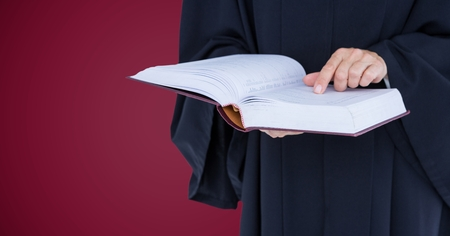 moving box: Digital composite of Judge mid section with open book against maroon background Stock Photo