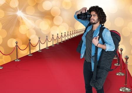 Digital composite of photographer taking a photo in the red carpet. Gold bokeh vbackground
