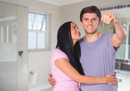 woman mirror: Digital composite of Couple Holding key in bathroom