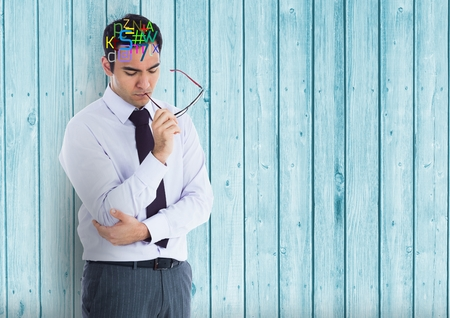guy standing: Digital composite of man thinking with colour letters on head
