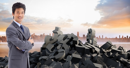 innumerable: Digital composite of Broken concrete stone with money symbol and businessman in cityscape Stock Photo