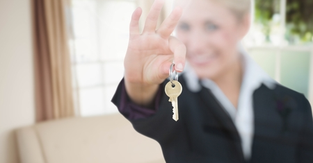 living room window: Digital composite of Woman Holding key  in home