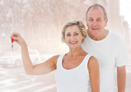 Digital composite of Couple  Holding key in front of street