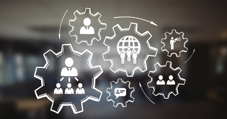 organisational: Digital composite of People in cogs graphics against office background Stock Photo