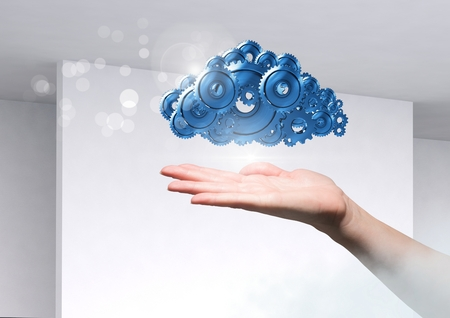 Digital composite of Open hand with cog gears cloud