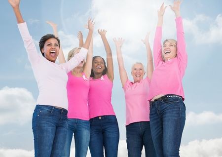 Digital composite of Breast cancer women with sky clouds background