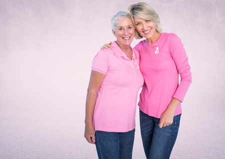Digital composite of pink breast cancer awareness women Stock Photo