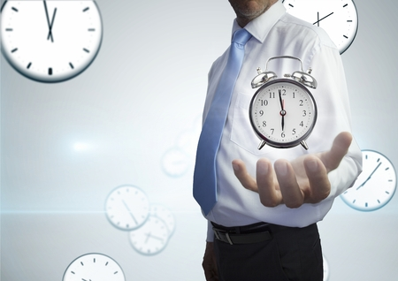 Digital composite of Business man holding a clock against background with clocks
