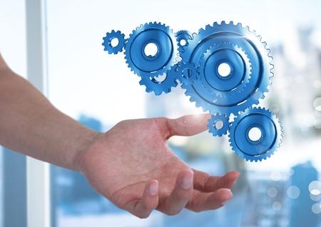 Digital composite of Open hand with cog gears