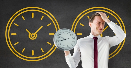 organisational: Digital composite of Worried business man holding a clock against background with clocks Stock Photo