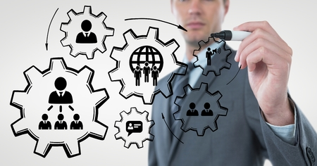 organisational: Digital composite of Business man interacting with people in cogs graphics against white background