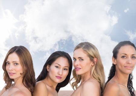 Digital composite of Beautiful Womens heads in sky clouds