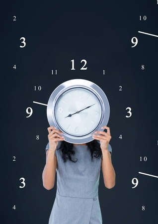 Digital composite of Business woman holding a clock against background with clocks